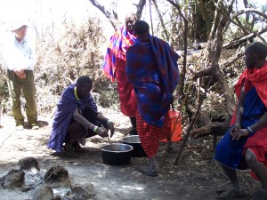 Masaai warriors stirring the stew