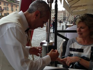 Rome 2 Waiter polishing Sandi's nails at Piazza Navarone restaurant