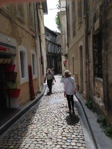Sandi walking down narrow street Avignon